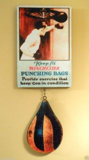1920s Winchester Punching Bags Sign with Die Cut Punching Bag