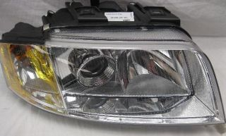 Hella W01331737107HEL Headlight Assembly Left Volkswagen Passat 2001