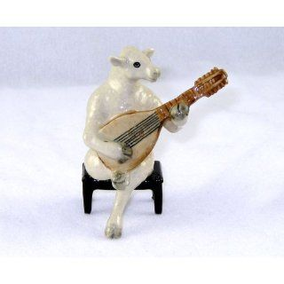 White SHEEP LAMB sits on a Bench plays LUTE MANDOLIN n