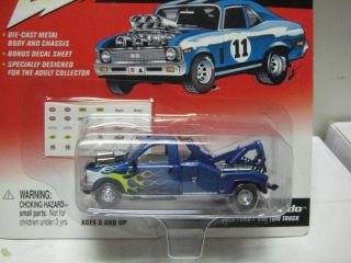 JOHNNY LIGHTNING REBEL RODS TOW NADO 2000 FORD F 550 TOW TRUCK MINT ON CARD