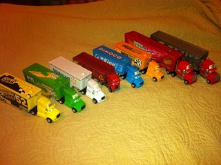 Eight (8) Disney Pixar Cars Haulers Mack, Jerry, King, Chick, Wally +3