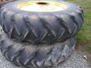 18 4 x 38 GY 6ply tires on John Deere tractor 9 bolt press steel rims
